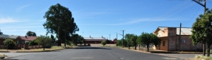 Photo of the wide street and old buildings leading up to the heritage Cobar railway station