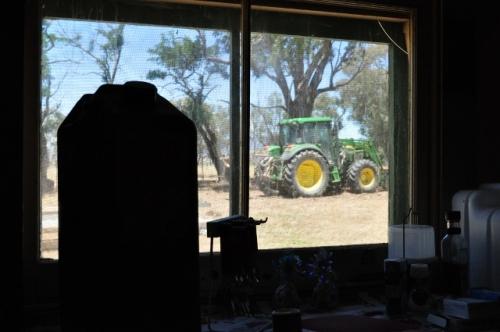 Big green John Deere tractor viewed through the kitchen window