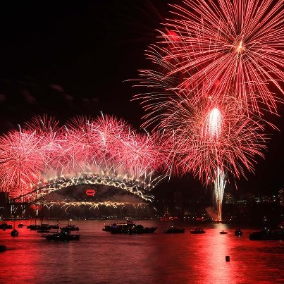 Fireworks over the Sydney Harbour Bridge, with a pair of red lips lighting up the structure
